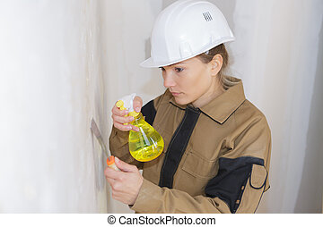 female plaster worker at a construction site