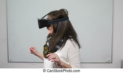 Female playing a video game with VR 3d special equipment headset during test