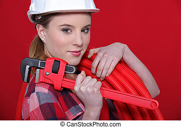 Female plumber equipped to fix problem