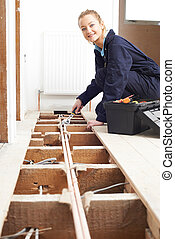 Female Plumber Fitting Central Heating System