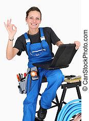Female plumber giving it the OK