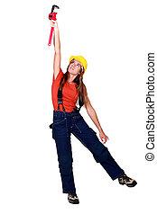 Female plumber holding wrench