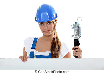 Female plumber with a lamp