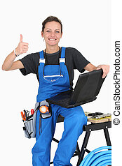 Female plumber with thumbs up