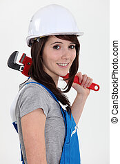 Female plumber with wrench