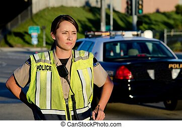 Female police officer - A female police officer staring and...