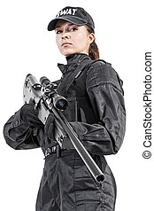Female police officer SWAT in black uniform with sniper...