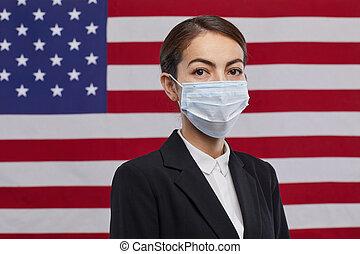 Female Politician Wearing Mask against American Flag