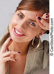 Smiling young woman close up