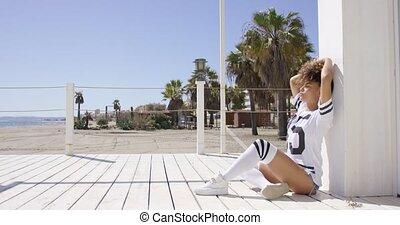 Female posing on beach background - Female wearing white...