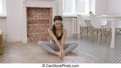 Female practicing yoga - Young female wearing sportswear and...