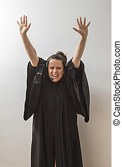 Female preacher - thirty something brunette woman dress as a...