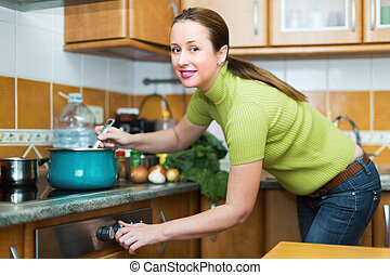 Female preparing meal in kitchen
