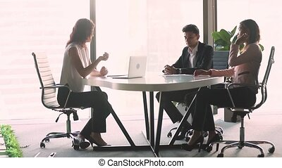 Female professional investment advisor consulting diverse client at business meeting