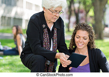 Female Professor Helping Grad Student - University professor...