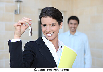 Female promoter showing keys of a house