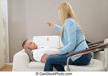 Psychiatrist Hypnotizing Patient - Female Psychiatrist...