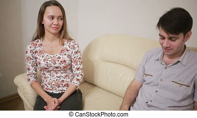 Female psychologist helping worried young couple. family therapy