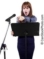 Female Public Speaker - girl in shiny dress speaking on a...