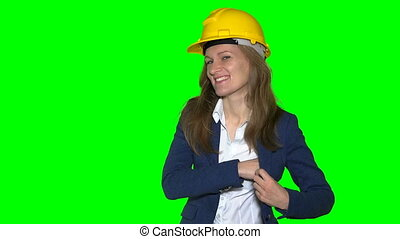 female real estate agent with helmet give new house keys to...