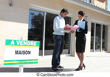 female real estate agent with male client