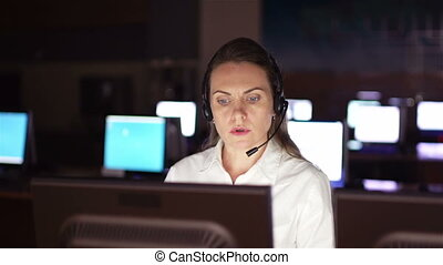 Female receptionist - Pretty operator consulting clients...