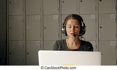 Female receptionist talking to customer on hotline. Woman...