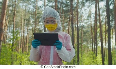 Female researcher collecting data in danger zone - Asian ...