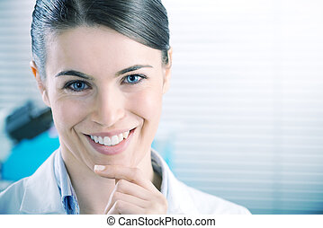 Female researcher smiling confidently