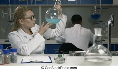 Female researcher working in chemistry lab - Female...