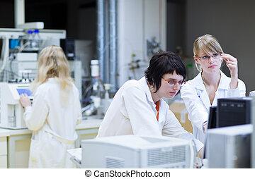 female researchers  in a lab