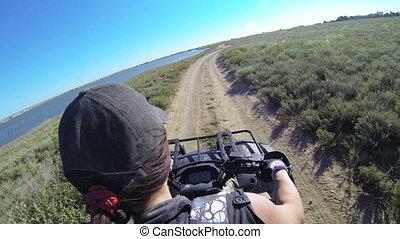 Female rider driving quad bike POV, GoPro Hero3 BE