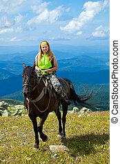 rider on horseback at mountains