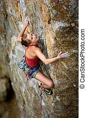 Female Rock Climbing - An eager female climber on a steep ...