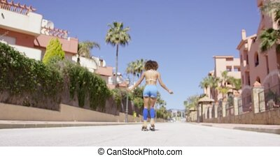 Female rollerskating on the road