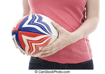 female rugby player with ball