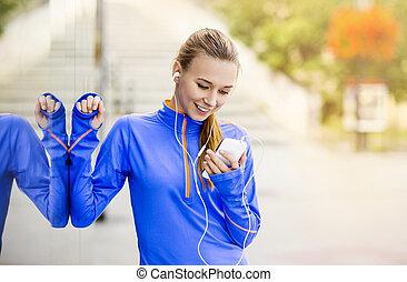 Female runner having break