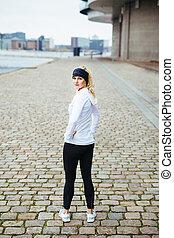 Female runner ready for a city run