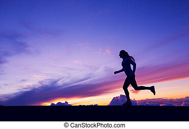 Female Runner Silhouette, Woman Running into sunset, colorful sunset sky