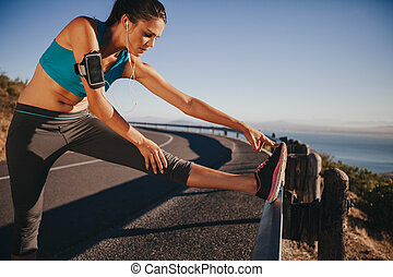 Female runner stretching before running - Female runner...