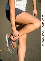 Female runner suffering ankle sprain sport  injury