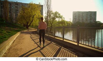 female runner trains in city