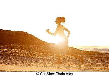 Female runner with sunset