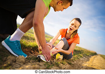 Female runner with twisted ankle