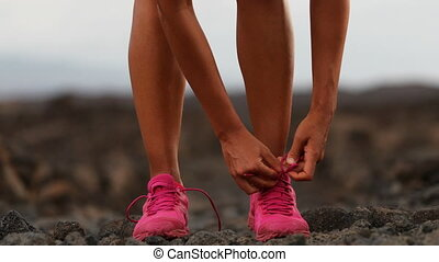 Female Running Athlete Tying Shoelaces On Running Shoes In ...