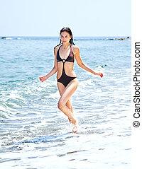 Female running beach