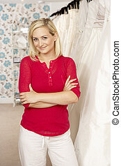Female sales assistant in bridalwear store