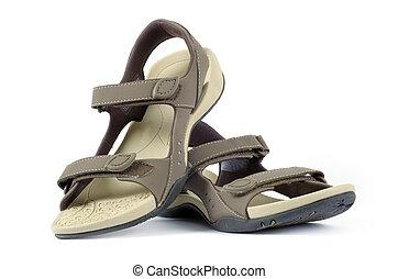 female sandals over white background