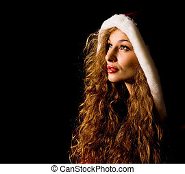 Female Santa - Portrait of pretty girl with hood on her head...