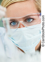 Female Scientific Research Doctor With Test Tube In Laboratory